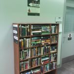 The Book Exchange bookshelf in the library