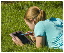 Student reading an eTextbook on a tablet