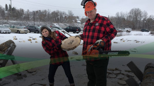 Sarah Freemark trying to steal a log cookie from Loggersports coach Chris Ryan