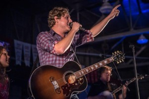 Musician Jason Blaine with guitar singing