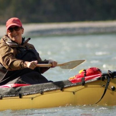 b6a43bd72d89 Outdoor Adventure graduate Joanne Smith - dressed in hat and coat in yellow  kayak on water